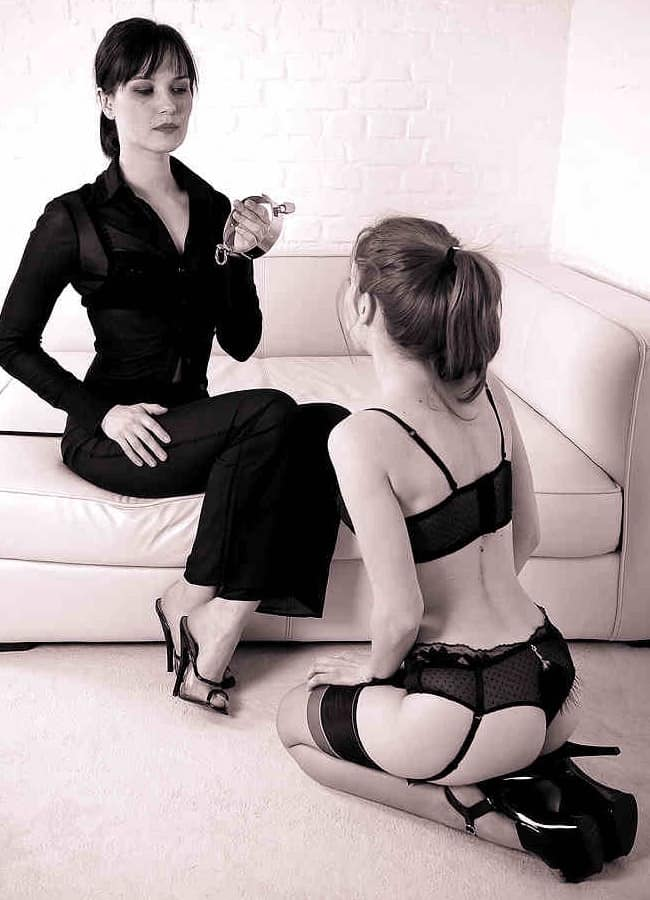 Lezdom mistress and her little slut on her knees