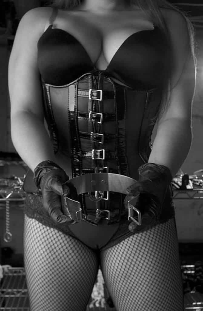 leather corset holding a metal collar