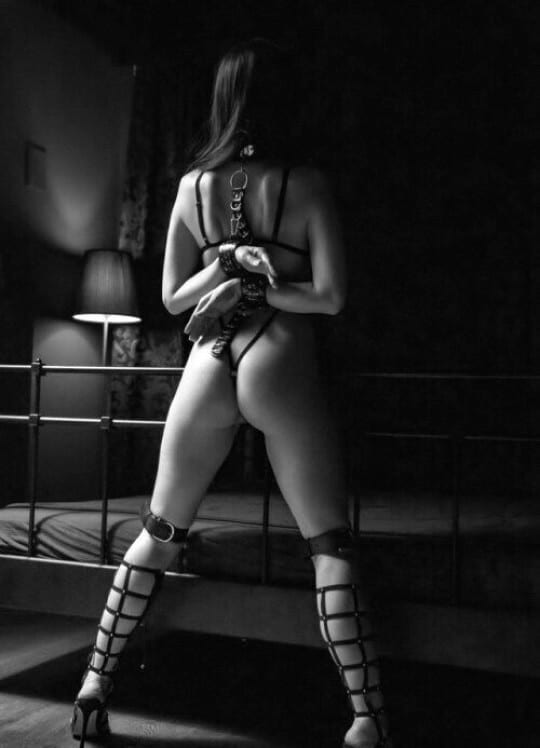 submissive in bondage from the back