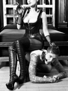 mistress sitting on a slave