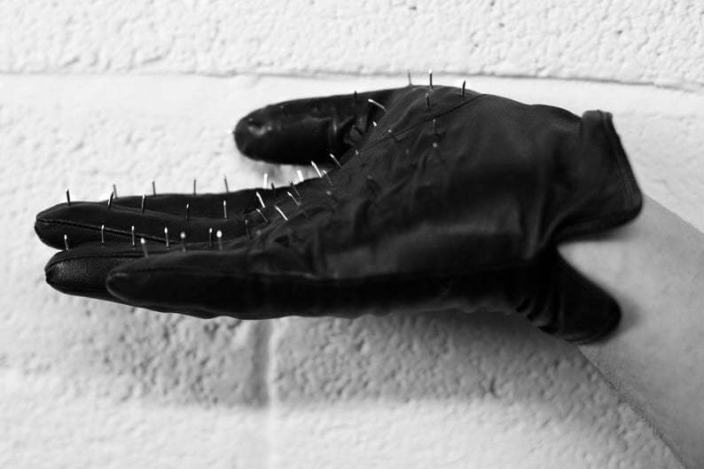 spiked glove for a handjob